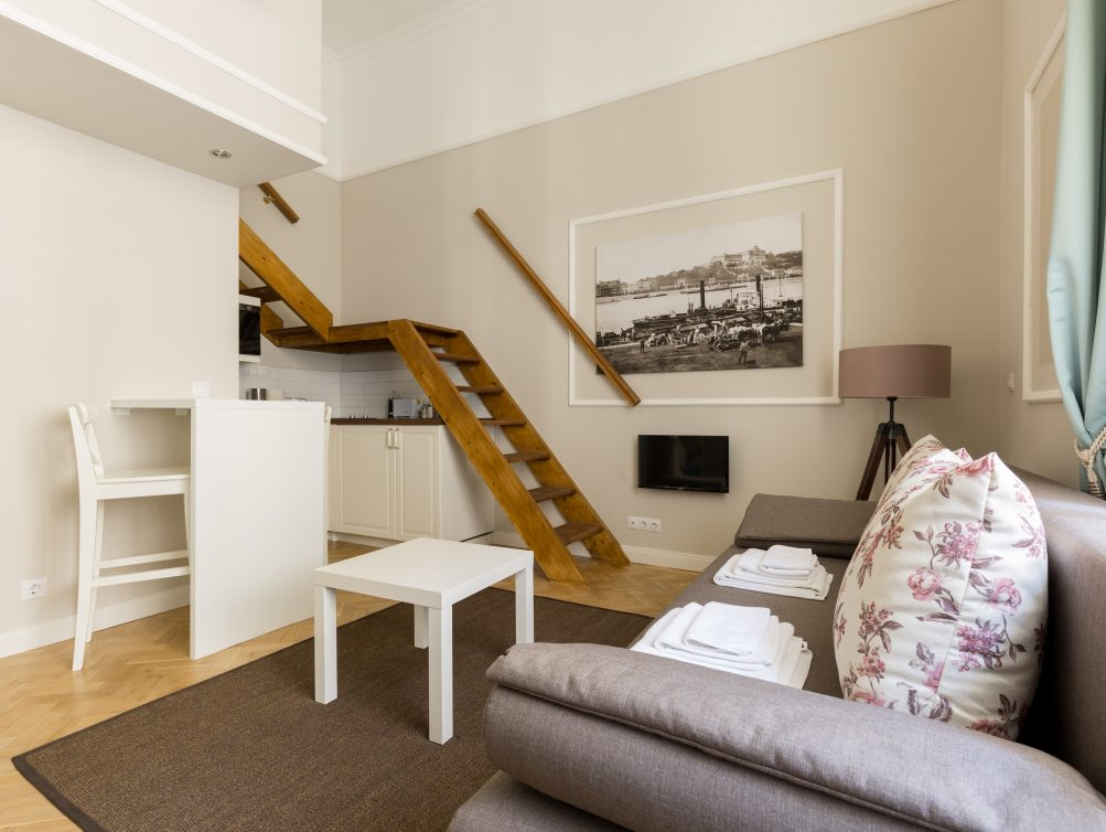 Large studio apartments Placement Stylish 22 Sqm Large Studio Apartment With Courtyard View Queen Size Bed 160 200 Cm Is On The Mezzanine And Foldable Sofa Bed In The Living Area Kecoos Holiday Apartments Lisianthus Apartments Studio Kecoos Holiday Apartments